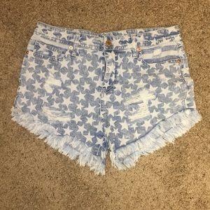 Distressed high rise denim shorts.